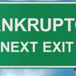 Highway sign saying bankruptcy next exit