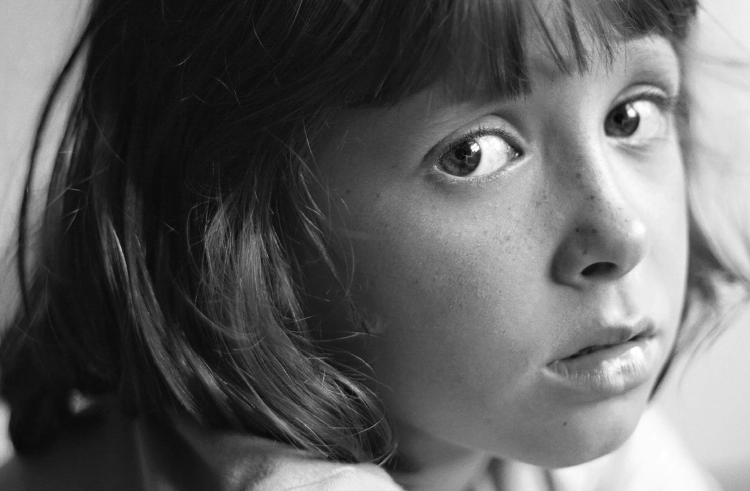 Young girl looking concerned