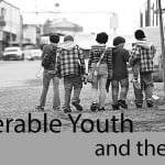 Cover Banner: Vulnerable youth and the law - photo of 5 pre-teens walking along a street