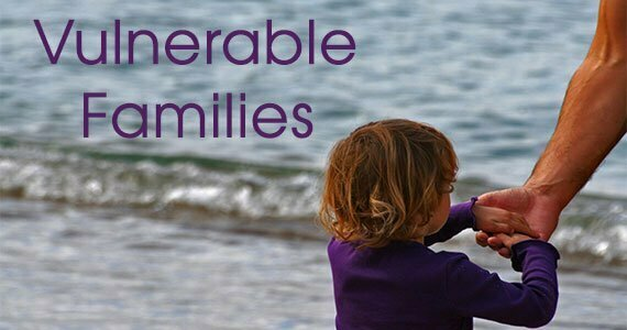 Cover banner: Vulnerable Families: photo of child with hands placed on top of man's hand