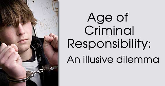 photo of a teen in handcuffs