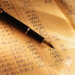 photo of a pen on a balance sheet