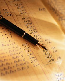 photo of a pen on a balance sheet