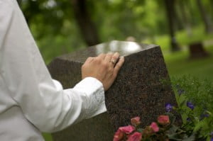 hand on grave stone