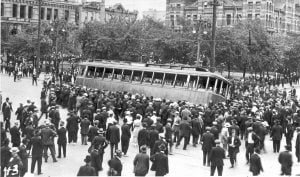 A streetcar is overturned in 1919 in the Winnipeg General Strike in front of the old city hall building on Main Street.